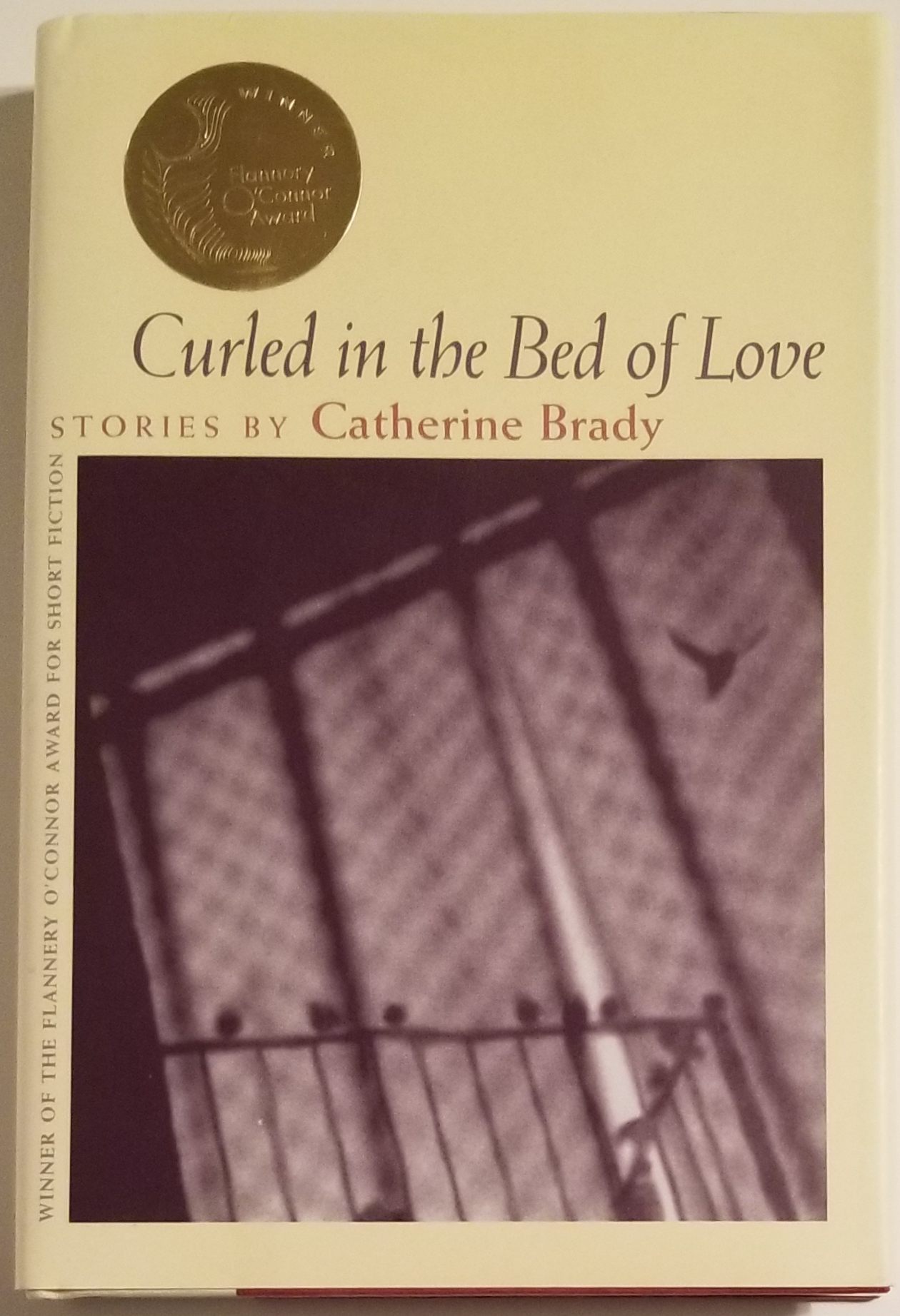 CURLED IN THE BED OF LOVE. Catherine Brady.