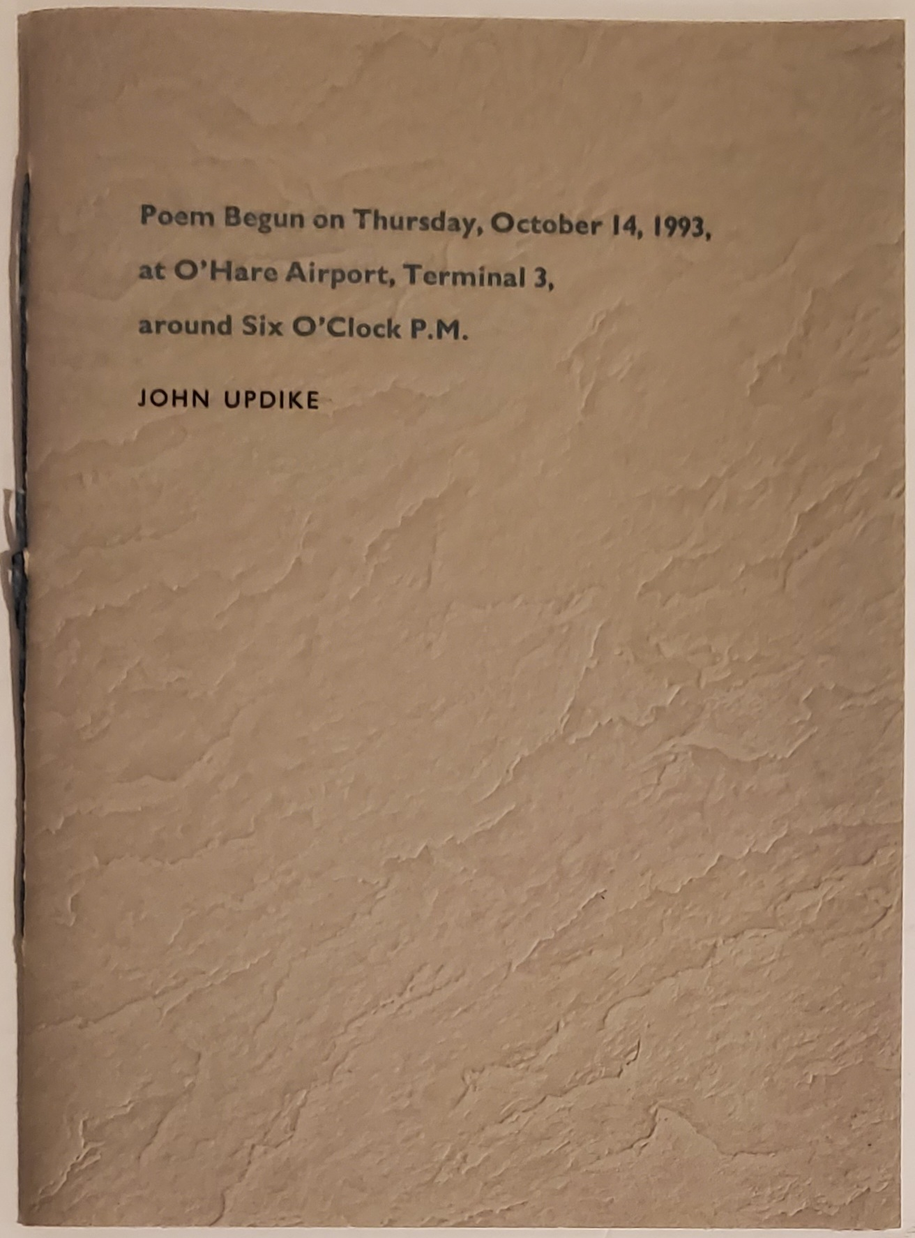 POEM BEGUN ON THURSDAY, OCTOBER 14, 1993, AT O'HARE AIRPORT, TERMINAL 3, AROUND SIX O'CLOCK P.M. John Updike.