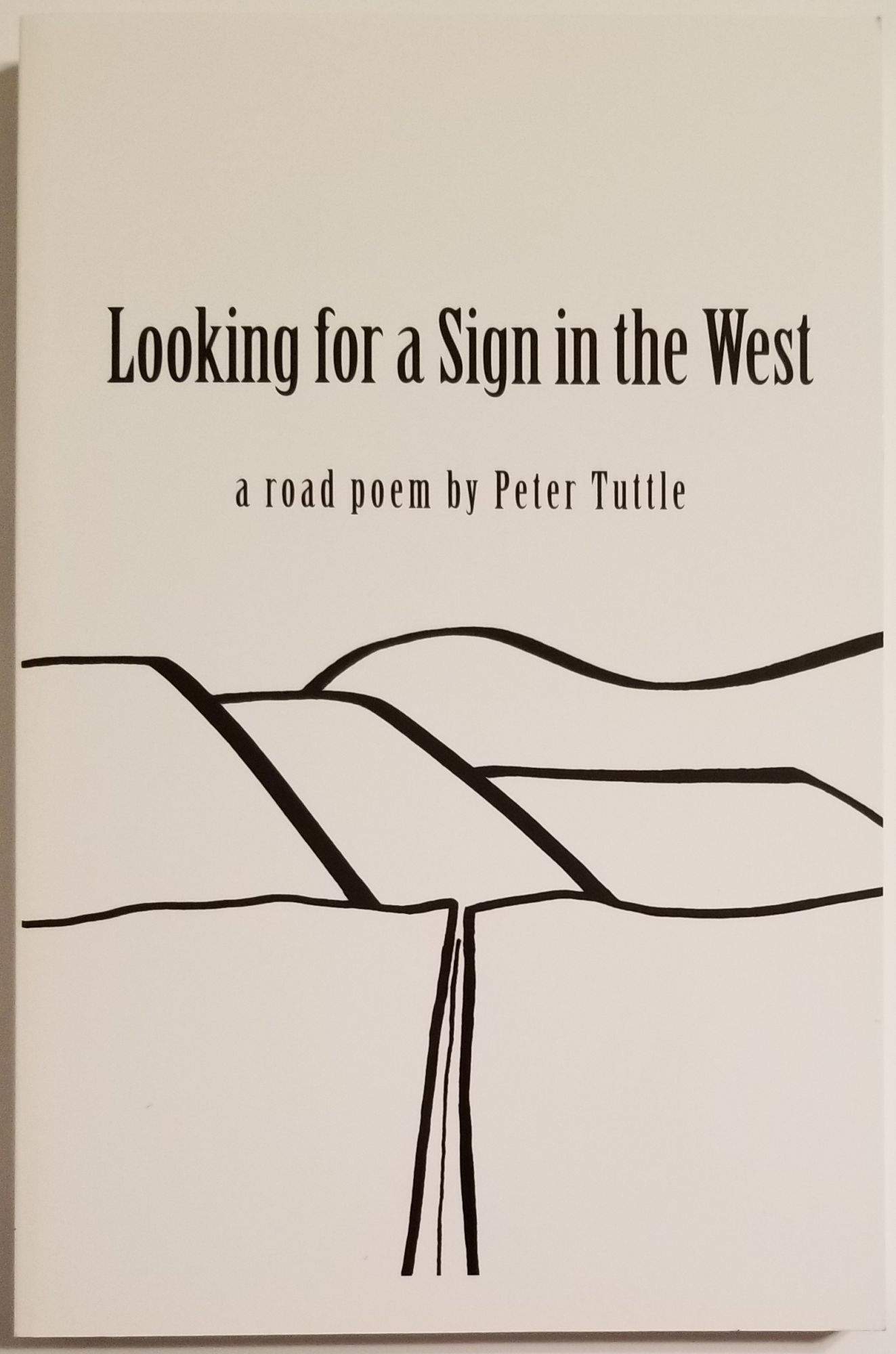 LOOKING FOR A SIGN IN THE WEST. Peter Tuttle.