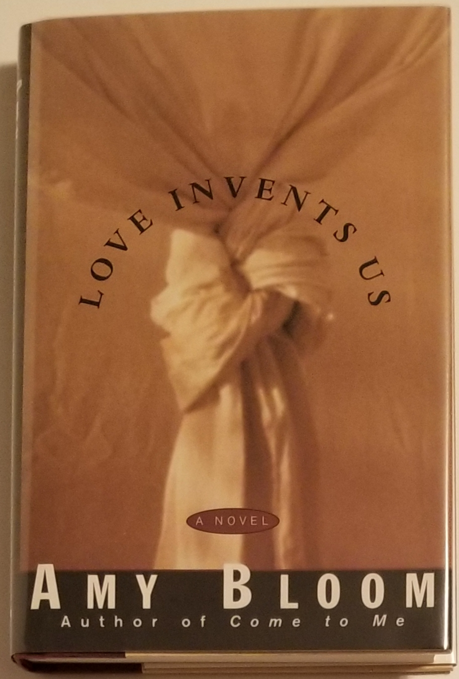LOVE INVENTS US. Amy Bloom.