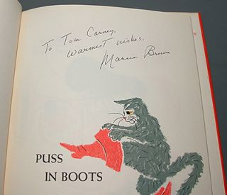 PUSS IN BOOTS. A Free Translation from the French of Charles Perrault and Illustrated by Marcia Brown.