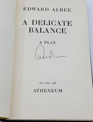 A DELICATE BALANCE [SIGNED]