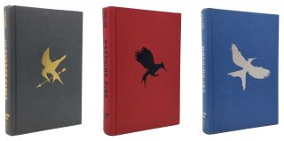 THE HUNGER GAMES TRILOGY: Hunger Games; Catching Firing; Mockingjay.